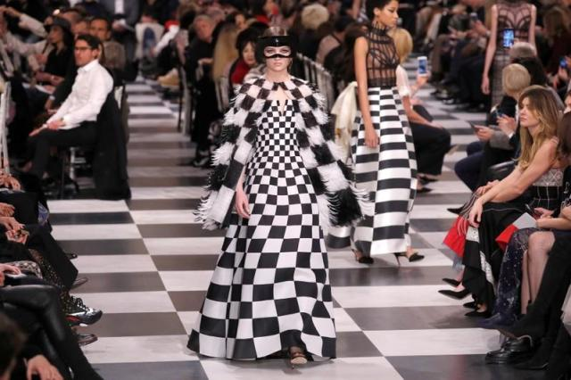 A model presents a creation by designer Maria Grazia Chiuri for Christian Dior's Haute Couture Spring-Summer 2018 fashion collection in Paris